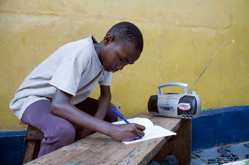 Jimmy Kamara, 9, is one of the students in Sierra Leone who use radios to continue their education while schools remain closed owing to Ebola.Tolu Bade/Courtesy of UNICEF